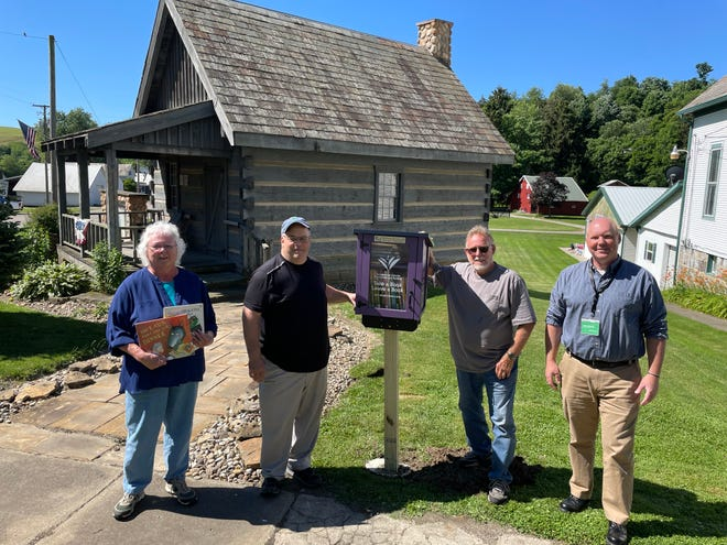 New Philadelphia president and Ragersville Historical Society Member Candy Beaber along with TCPL maintenance assistants Dave Poling and Dave Miller and TCPL Assistant Director Brian Herzog pose with their newest Little Free Library.