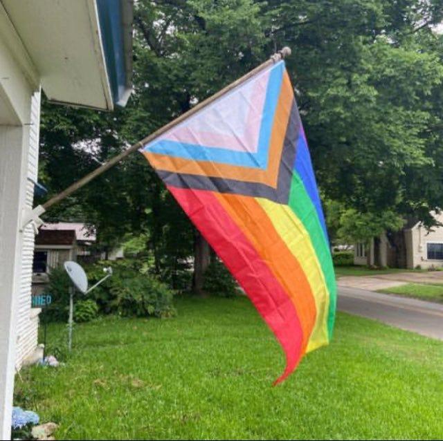The Progressive Pride Flag flies outside the Robertson's home in Paris.