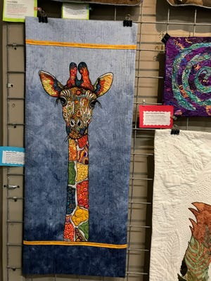 This quilted image of a giraffe by Beverly Rider of Midlothian was inspired by a magazine page. The Creative Quilters Guild of Ellis County is displaying its quilts through the end of July at Art on the Square in Waxahachie.