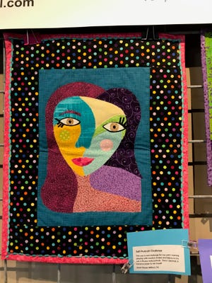 Janet Nazar of Milford made this Picasso-like self-portrait as part of a Creative Quilters Guild of Ellis County challenge. The guild's quilts are on display at Art on the Square for the rest of this month.