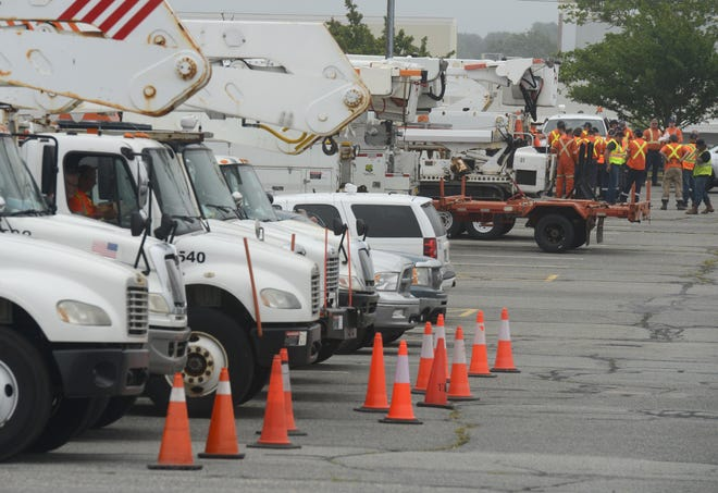 HYANNIS 07/08/21 Over 60 trucks from Holland Power Services, based in Canada, made a nine-hour drive to stage in the old Kmart parking lot as they wait for the arrival of Tropical Storm Elsa, which is forecast to be over Cape Cod on mid-day today.