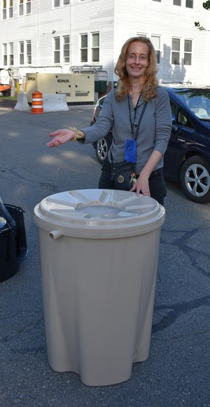 Carol Zoubeck of Wakefield is pleased with the new compost recycling bin she purchased through the Department of Public Works and its partnership with Earth Machine. The DPW-sponsored program provided residents with the opportunity to buy a bin at a reduced price.