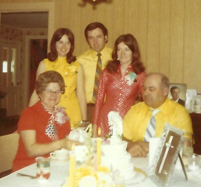 The Curran family gathers in April 1971 to celebrate the 25th wedding anniversary of Mary Curran and Thomas Curran Sr., seated, three months before the murder of their eldest daughter, Rita Curran, standing at right with her siblings, Mary Curran Campbell and Thomas Curran Jr.