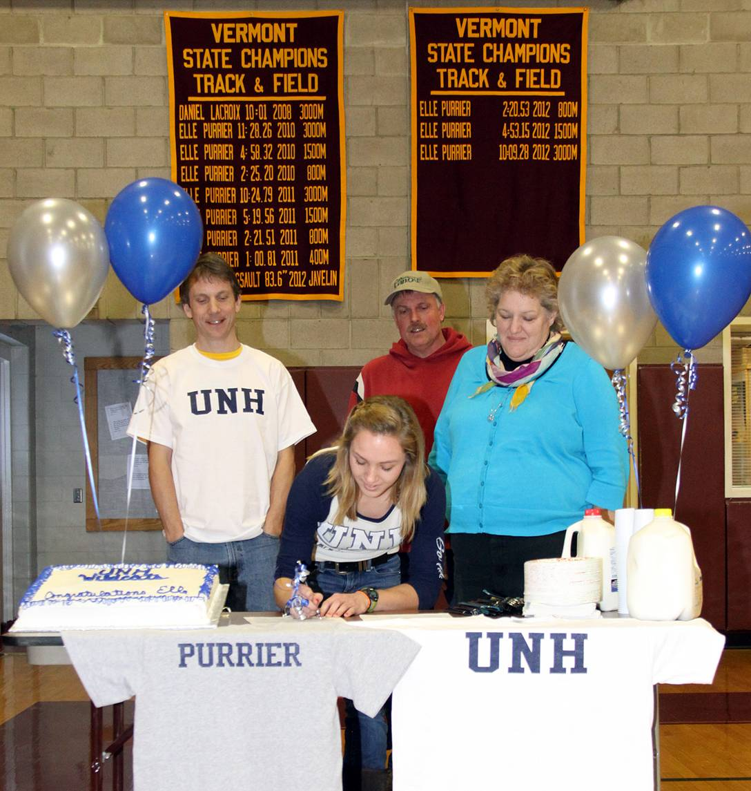 Elle Purrier St. Pierre signs her National Letter of Intent with New Hampshire in this February 2013 file photo. Purrier's coach, Andrew Hathaway (left) and her parents, Charles and Annie Purrier, look on during the signing in the Richford High School gym.