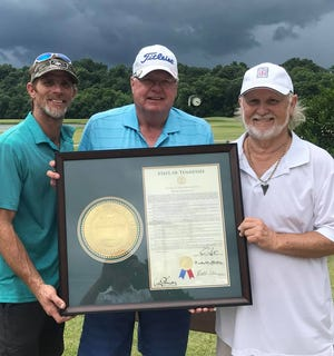 Bobby Keel, right, accepts a framed Joint House Resolution from Rep. Curtis Johnson, center. At left if Keel's son, Robby Murphy.