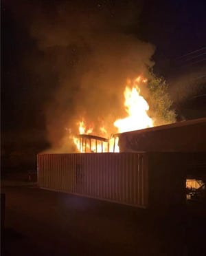 A trailer set on fire behind Hananoki Japanese Steakhouse on Madison Street on July 8, 2021