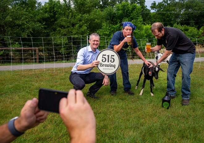 Pete De Kock, Clive Assistant City Manager, 515 Head Brewer Barb Becker, and 515 owner Ryan Rost, pose for photos with goats outside the brewery in Clive, Friday, July 9, 2021. Clive is partnering with 515 Brewing for a special flavored beer, products and glasses to support the Clive Greenbelt program.