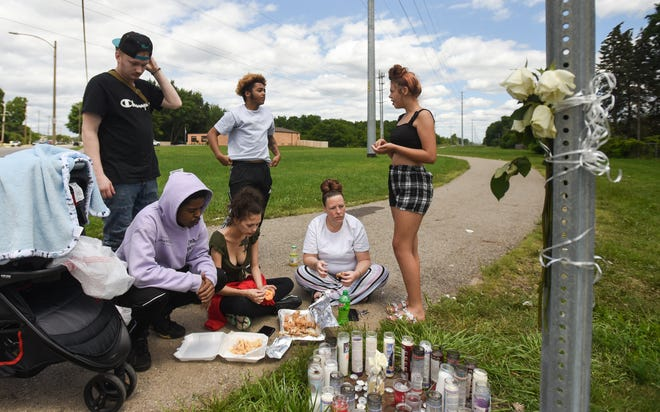 Friends and family of Janessa Bartholomew-Hayter gather near West Northrup Street and South Martin Luther King Boulevard on July 9, 2021, to mourn her passing. She died in a car crash on July 8.