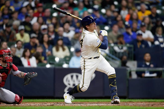 Avisail Garcia of the Milwaukee Brewers hits a two-run home run in the eighth inning to give the Brewers a 5-3 victory in the first game of a four-game series against the Reds.