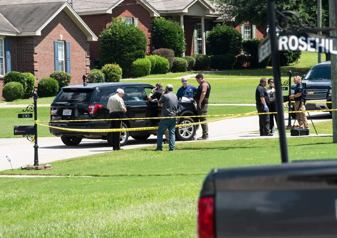 Montgomery County Sheriff's Office investigates a death on Lakeshore Drive in Pike Road, Ala., on Friday, July 9, 2021.