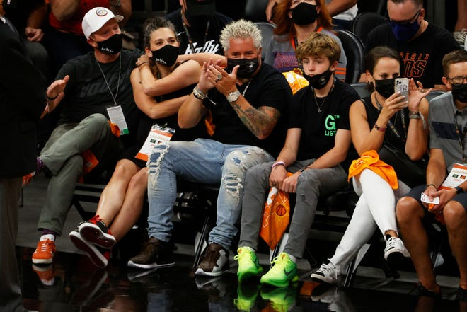 Food Network star Guy Fieri sits courtside and watches Game 2 of the NBA Finals between the Milwaukee Bucks and the Phoenix Suns at Phoenix Suns Arena on July 08, 2021 in Phoenix, Arizona.