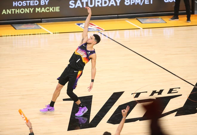Phoenix Suns guard Devin Booker (1) makes a three point basket against the Milwaukee Bucks during Game 2 of the NBA Finals at Phoenix Suns Arena July 8, 2021.