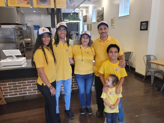 From right to left: Youssef Ibrahem, Neama Khalil and Felo Malak pose with their family in their new restaurant, Neama's Egyptian Food. The restaurant, located at 24 N. George St. in York City, will have a soft opening Saturday, July 10.
