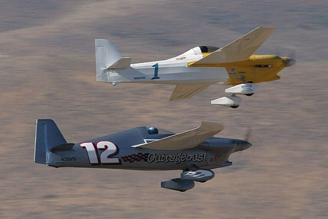 Two airplanes zoom through the sky. An air racing championship, Air Race 1, is coming to San Angelo in October 2021.