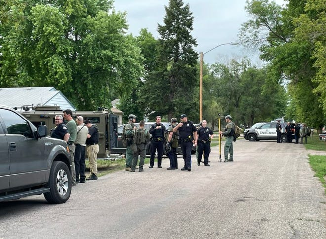 Sioux Falls police and Minnehaha County sheriff's deputies gather after arresting Miguel Nunez Jr. on the 3400 block of N. Sixth Avenue in Sioux Falls on Thursday night.