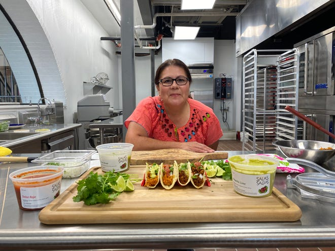Patricia Burbine prepares dishes in a commissary kitchen for Salas Salsas.