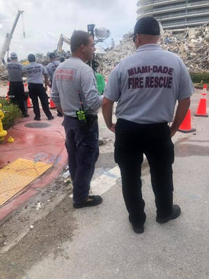 A team of firefighters led by Oxnard Fire Chief Alex Hamilton has been supporting crews working at the collapsed condo building in Surfside, Florida.