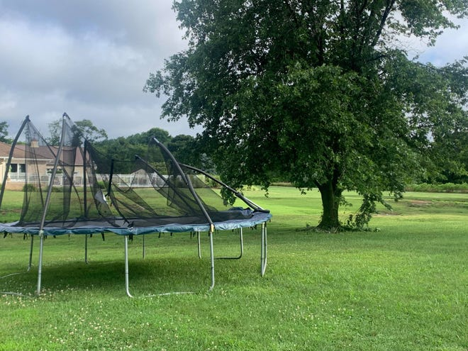 Chris Gordy Miller, who lives on Robinsonville Road in Lewes, found her large trampoline on the other side of her fence after strong winds came with Tropical Storm Elsa Friday morning.