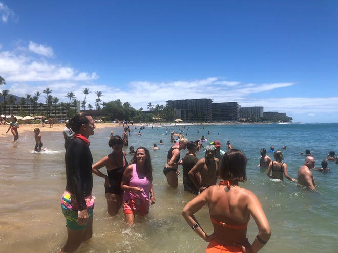 Kaanapali Beach, a popular tourist spot on the Hawaiian island of Maui, was busy on Monday, July 5. Maui  tourism, which essentially shut down for 7 months during the coronavirus pandemic, is approaching pre-pandemic levels by some measures.