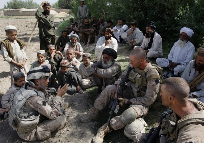 his July 2, 2009 photo shows Josh Habib, far left, a 53-year-old translator for the U.S. Marines, speaking with Afghan villagers and two Marines in the Nawa district of Afghanistan's Helmand province. Fort Lee has been picked to house the first group of 2,500 Afghan citizens, including translators and their families, as they seek residency in the United States.