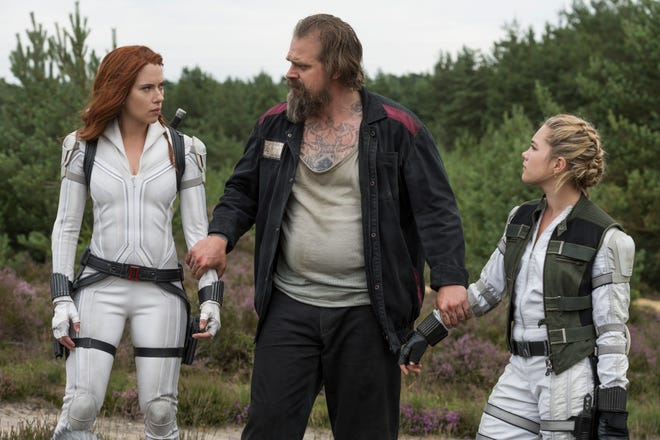 "Alexei (David Harbour, center) is father figure to Natasha (Scarlett Johansson) and Yelena (Florence Pugh) in Marvel's ""Black Widow."""