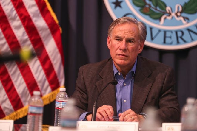 Gov. Greg Abbott, shown at a briefing last month, has signed executive orders prohibiting school districts and local officials from setting their own mask mandates.
