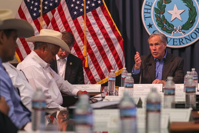 Governor Greg Abbott holds a border security briefing with sheriffs from border communities at the Texas State Capitol on July 10. [AMERICAN-STATESMAN/FILE]