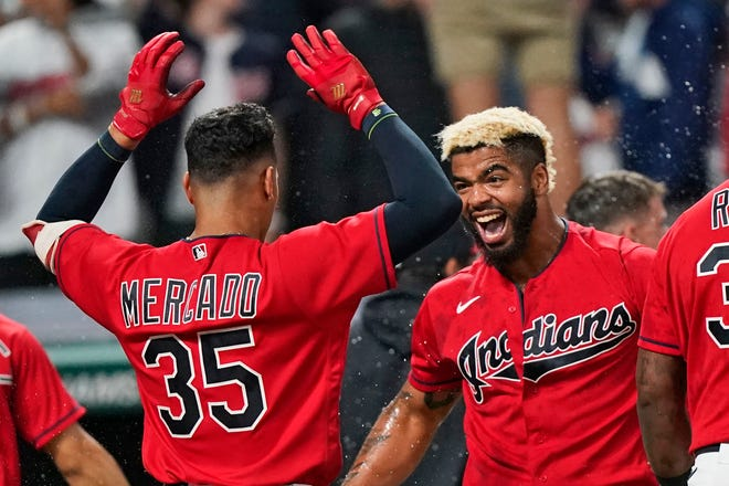 Cleveland first baseman Bobby Bradley, right, is congratulated by Oscar Mercado after Bradley hit a solo game-winning home run in the ninth inning of a 2-1 win over the Kansas City Royals on Friday night at Progressive Field. [Tony Dejak/Associated Press]