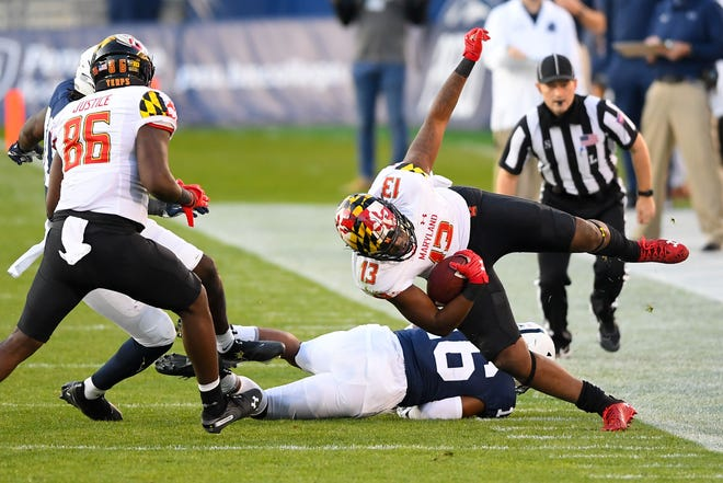 Maryland running back Peny Boone gets tripped up by Penn State safety Ji'Ayir Brown during their game last November at Beaver Stadium. Brown is in the mix to become a much bigger part of the Nittany Lions' defense this season.