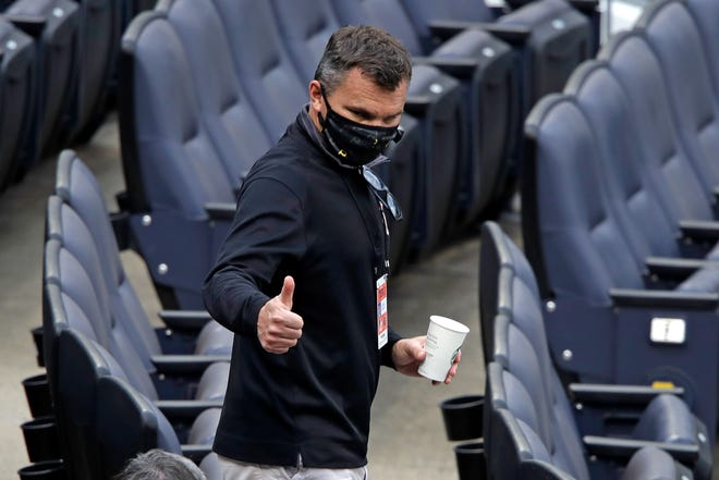 Pittsburgh Pirates General Manager Ben Cherington walks in the seats behind home plate between innings of the team's intrasquad baseball game at PNC Park in Pittsburgh, Monday, July 13, 2020. (AP Photo/Gene J. Puskar)