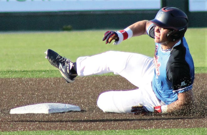 Bartlesville Doenges Ford Indian veteran standout Braeden Winters powers into second base during Friday's regional game at Bill Doenges Memorial Stadium. Winters accounted for all five Indians' runs, including a grand slam homer in the seventh, in the 6-5 loss.