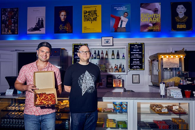 Cape Cinema in Dennis is led by Executive Director Josh Mason, left, and General Manager John Crowly. The cinema has added pizza, cookies, coffee, and other snacks to their snack bar. The food is sourced from local restaurants as a community-building effort.