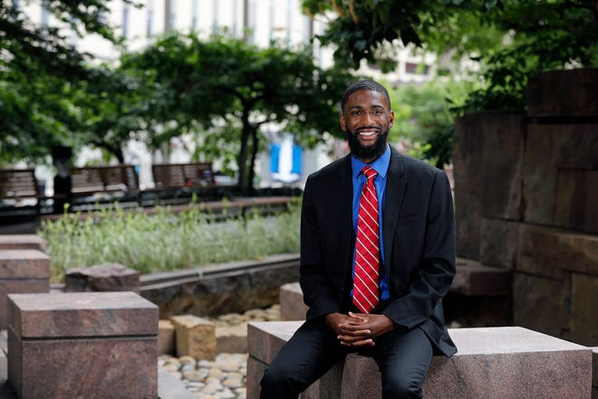 Aaron Ervin, a 2021 graduate of Hampton University, poses for a photo outside of Nationwide Insurance. Ervin interned with Nationwide and now works full-time on the retirement solutions internal sales team.