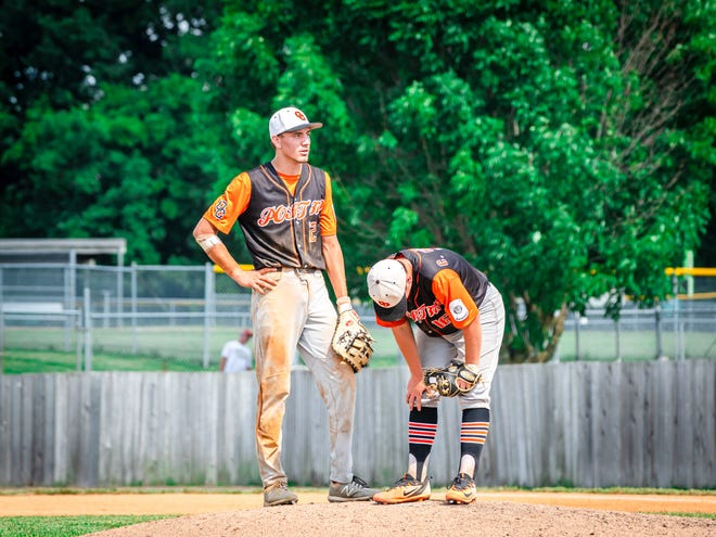 Oak Grove Post 379 starting pitcher Connor Hernandez, right. bends over with exhaustion as he and teammate Brody Armstrong wait for a new pitcher in their pool play game against Omaha (Neb.) Post 211 PDG Storm Thursday. Oak Grove lost 11-2 and finished 2-2 in pool play after starting 2-0.