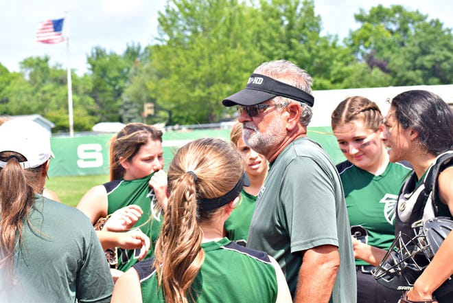 West Burlington-Notre Dame coach Dave Oleson huddles with his players between innings in Friday's Class 3A regional semifinal game against Davis County at Barb Carter Field. Davis County won, 2-1.