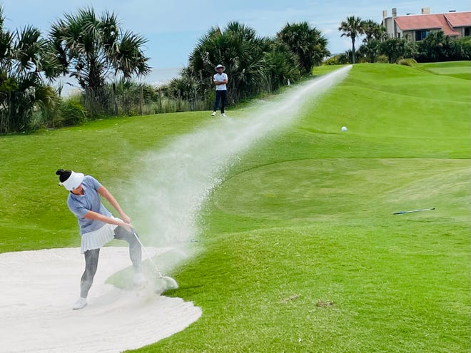 Elle Nachmann of Boca Raton blasts out of a bunker near the 16th green of the Amelia Island Club at Long Point on Saturday. Nachmann shot 68 to take a four-shot lead in the Florida Women's Stroke Play Championship.