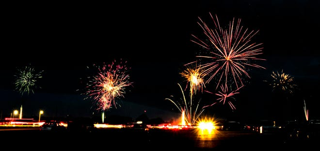 Although the City fireworks display began prior to dusk, after the show was done another show began as area residents began lighting off their fireworks south of the Arkansas River bed on July 4.