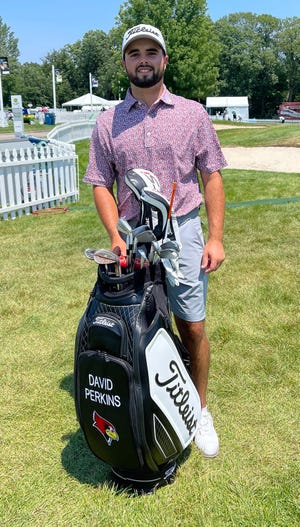 David Perkins poses with his golf bag this week at the John Deere Classic in Silvis. The East Peoria native and former Illinois State golfer made his PGA Tour debut.
