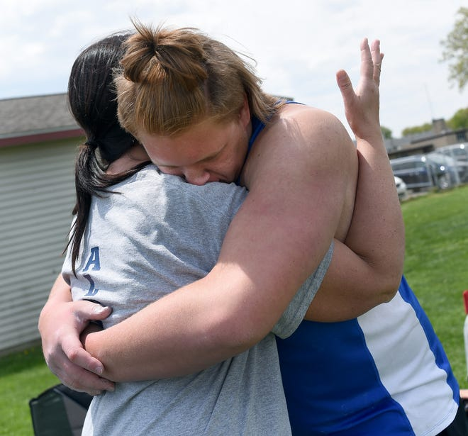 Alex Mansfield hugs his mother, Rebecca Mansfield, after breaking Jefferson's school record in the shot-put at the Mason Invitational. Mansfield has been named the Monroe County Region Boys Track and Field Athlete of the Year.