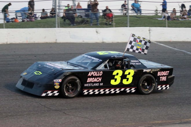 Greg Studt takes a victory lap after winning a race at Flat Rock Speedway.