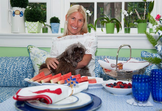 Lori Jayne Bernstein, shown with her dog, Barkley, has been designing, manufacturing and personalizing linens and home accessories for decades.