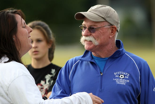 Scituate girls soccer head coach Bubba Parmenter, wearing his 2006 Division I championship jacket, talks with an assistant coach during practice in 2007.