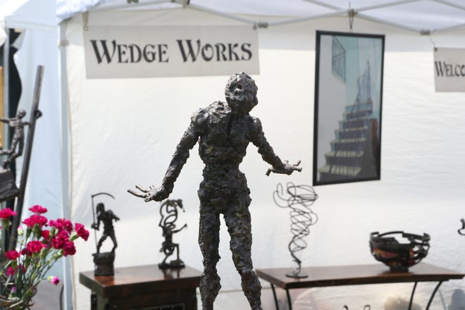 Metal sculptures are on display at the Wedge Works tent.