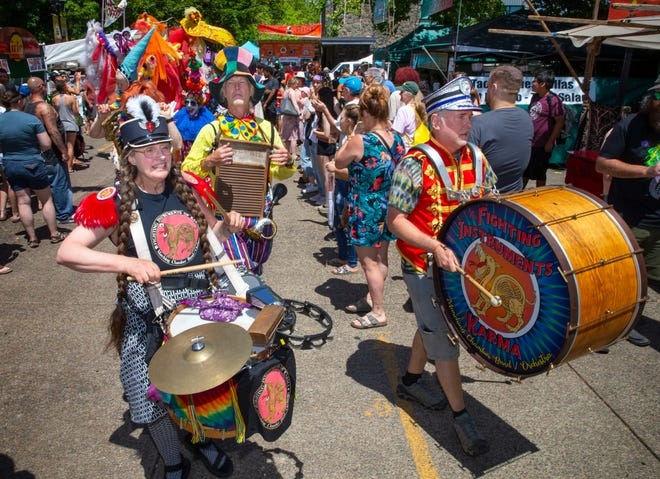 The Fighting Instruments of Karma Marching Band entertains visitors to the Saturday Market as the 2021 Fair in the Clouds streams virtually and in person from several locations around Eugene.