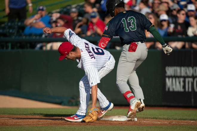 South Bend Cubs pitcher Ryan Jensen (6) steps on the base prior to Beloit Snappers infielder Ynmanol Marinez (13) for the out during the South Bend Cubs-Beloit Snappers baseball game on Friday, July 09, 2021, at Four Winds Field in South Bend, Indiana.