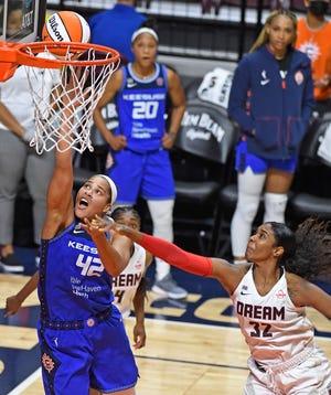 Connecticut Sun center Brionna Jones (42) scores around the defense of Atlanta Dream forward Cheyenne Parker (32) during the Sun's 84-72 win Friday in Uncasville.