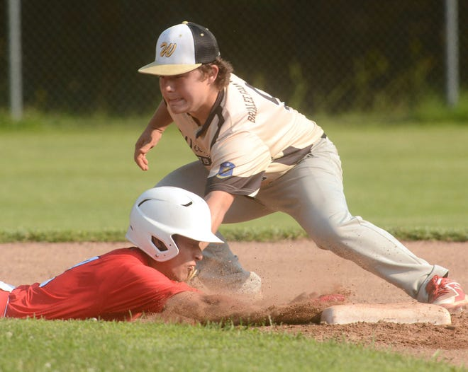 Willimantic's Noah Woodmansee applies a tag on Norwich's Anthony  Sanchez during an American Legion game at Dickenman Field in Norwich.