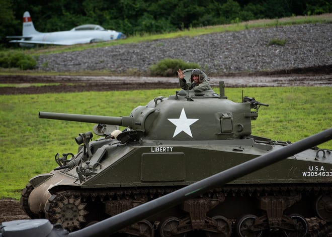 A restored tank rumbles by during the Tank Demonstration Weekend at the American Heritage Museum on Saturday in Hudson.