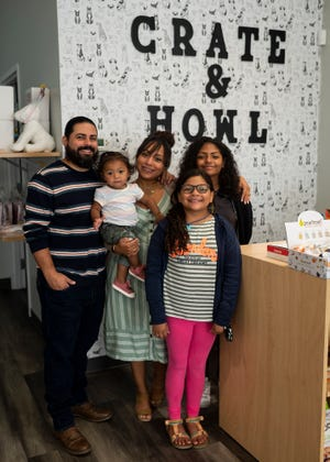 WORCESTER - Brooklyn, 14, and Evian Flores, 10, recently helped their parents, Jamie and Giselle Rivera-Flores, holding little Shia, come up with the idea for Crate and Howl, a dog supply store that promotes healthy and environmentally friendly products for dogs.