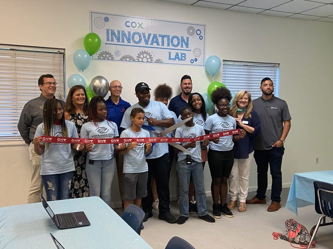 Local Cox employees, staff and Club Kids from the Boys and Girls Club, unveiled a new Innovation Lab at the Boys and Girls Woodland Park unit.